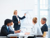 Young business woman explaining during a meeting